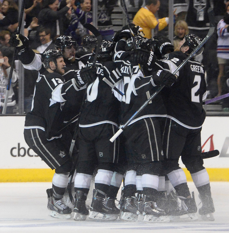 . The Los Angeles Kings celebrate after they defeated the New York Rangers in overtime 3-2 in game 1 of the Stanley Cup Finals. Los Angeles, CA. 6/4/2014(Photo by John McCoy / Los Angeles Daily News)