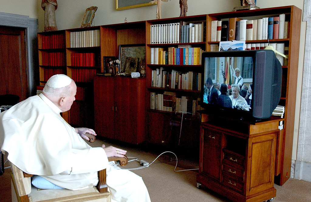 . In this photo made available by the Vatican newspaper Osservatore Romano, Pope John Paul II follows the Easter Mass in St. Peter\'s Square from his studio at the Vatican, Sunday, March 27, 2005. For the first time since John Paul II\'s papacy began in 1978, Easter Sunday Mass at the Vatican was celebrated without the pope as he continued his convalescence following two recent hospitalizations for breathing crises. For years, John Paul also has suffered from Parkinson\'s disease.  (AP Photo/Osservatore Romano, ho)