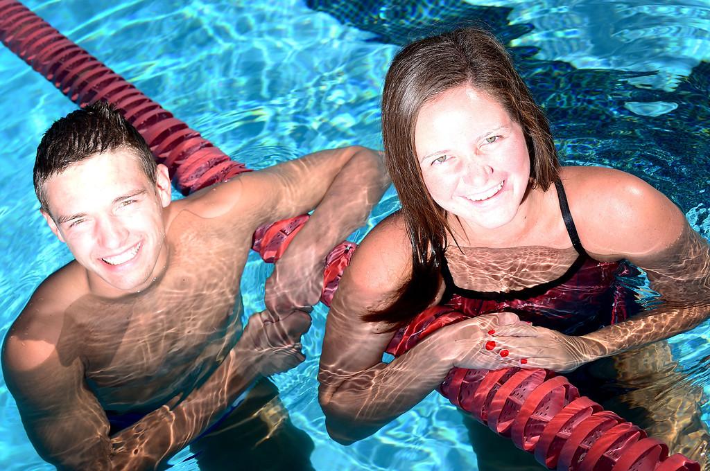 . Austin Garcia, of San Dimas High, and Nicole Gautreau, of Glendora High, both 18 and seniors who won CIF-SS swimming events this year, pose Thursday May 30, 2013 at Glendora High School. (SGVN/Staff Photo by Sarah Reingewirtz)
