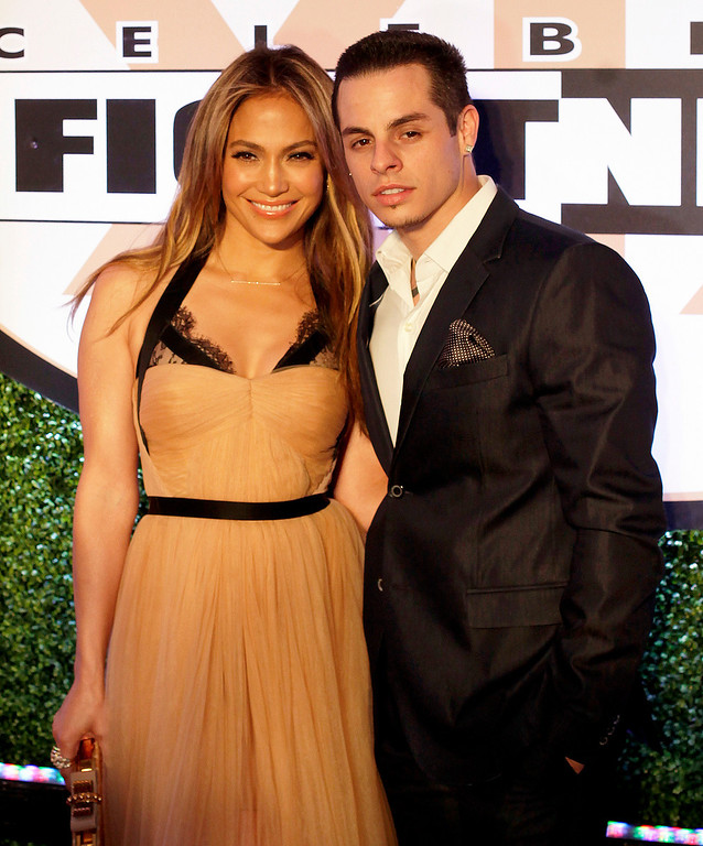 . Actress and entertainer Jennifer Lopez and Casper Smart arrive at Muhammad Ali\'s Celebrity Fight Night XIX at the JW Marriott Desert Ridge Resort and Spa, Saturday, March 23, 2013, in Phoenix. (Photo by Rick Scuteri/Invision/AP)