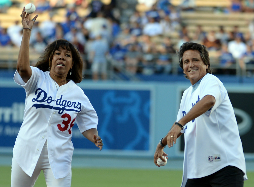 . Joni Campanella, left, daughter of Roy Campanella and Mark Reese son of Pee Wee Reese throw out the ceremonial pitch on their parents bobble head night prior to a Major league baseball game between the San Diego Padres and the Los Angeles Dodgers on Saturday, July 12, 2014 in Los Angeles.   (Keith Birmingham/Pasadena Star-News)