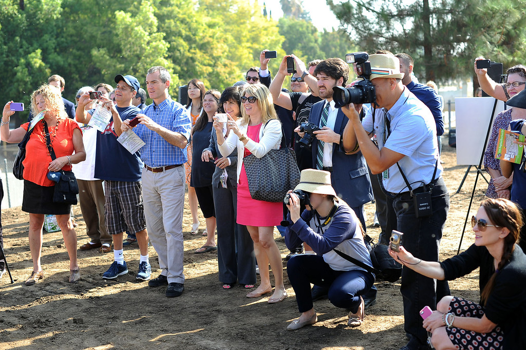 . Onlookers document the groundbreaking ceremony for the LA Riverfront Park project in Sherman Oaks, CA September 18, 2013.  The park will be part of a proposed ¼ mile stretch of bike path that will run alongside the river bank on what is currently used as a maintenance access road. (Andy Holzman/Los Angeles Daily News)