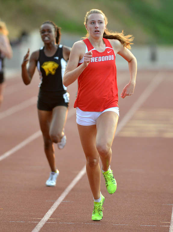 . 05-03-2013-(LANG Staff Photo by Sean Hiller)-  The Bay League track and field finals Friday night at Mira Costa High School. Redondo\'s Anavey Hiehle  wins the girls varsity 400 meter dash.