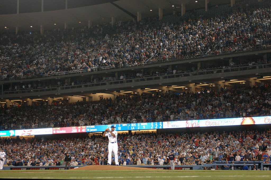 . Dodger fans cheer with two outs in the ninth inning and closer Kenley Jansen on the mound against the Red Sox, Friday, August 23, 2013. (Michael Owen Baker/L.A. Daily News)
