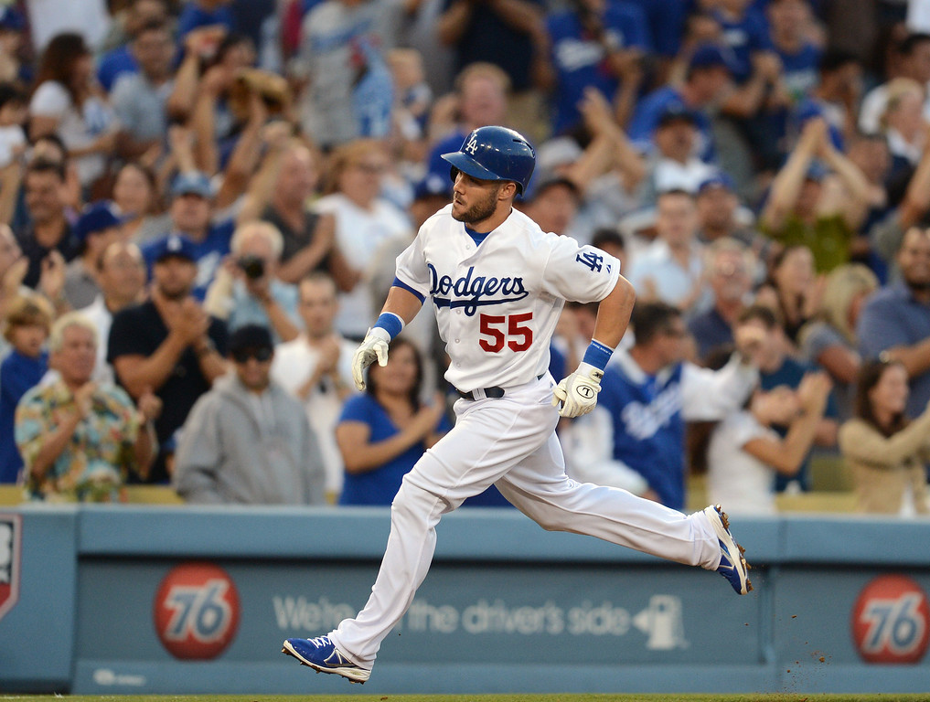 . The Dodgers\' Skip Schumaker #55 heads for home after hitting a 2 run homer in the 5th inning during their game against the Reds  at Dodger Stadium in Los Angeles Saturday, July 27, 2013. (Hans Gutknecht/Los Angeles Daily News)