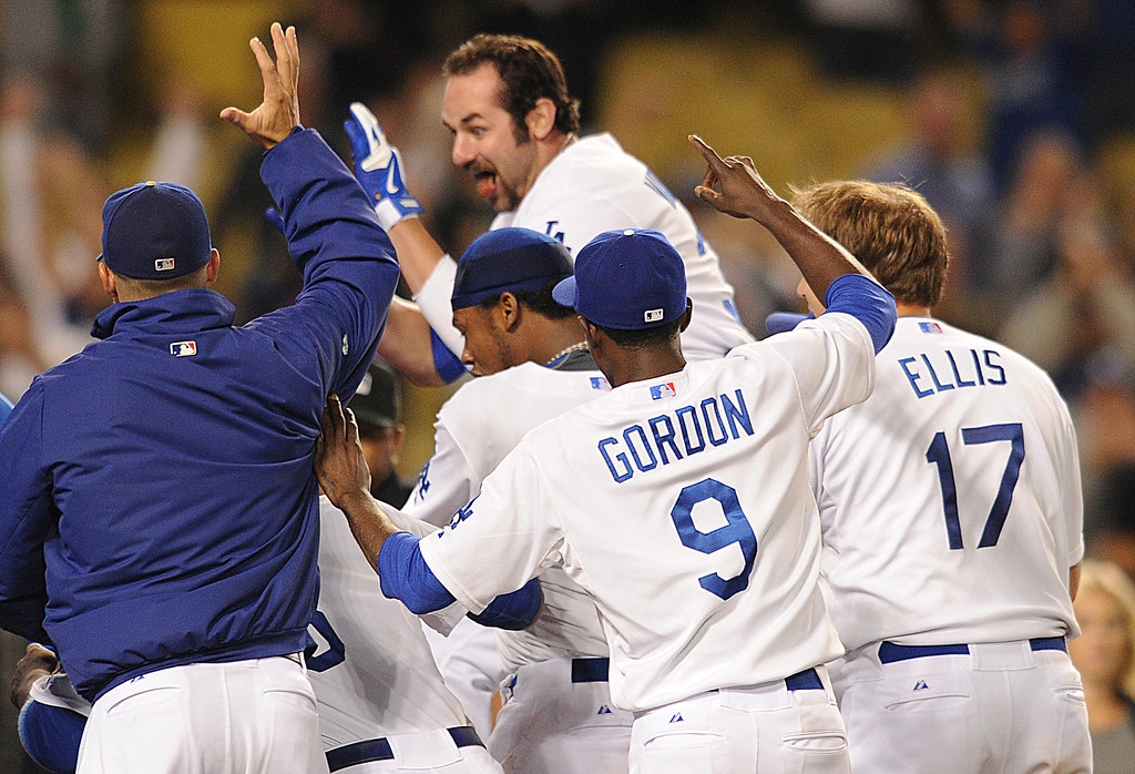 . Scott Van Slyke has his tounge hanging out as he comes home. The Dodgers defeated the Arizona Diamondbacks 5-3 after Scott Van Slyke hit a 2 run walk off homer in the 11 inning at Dodger Stadium in Los Angeles, CA. 9/10/2013. photo by (John McCoy/Los Angeles Daily News)