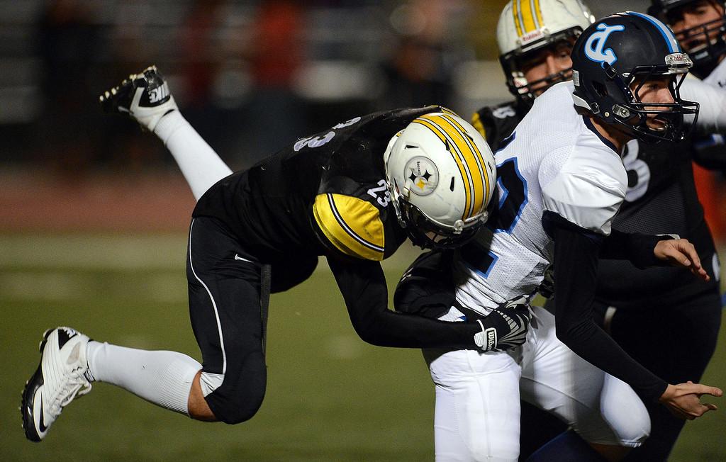 . Bassett\'s Jesus Navarrete (23) tackles Duarte quarterback Isaiah Scott (12) in the first half of a prep football game at Bassett High School in La Puente, Calif., on Friday, Nov. 1, 2013.    (Keith Birmingham Pasadena Star-News)
