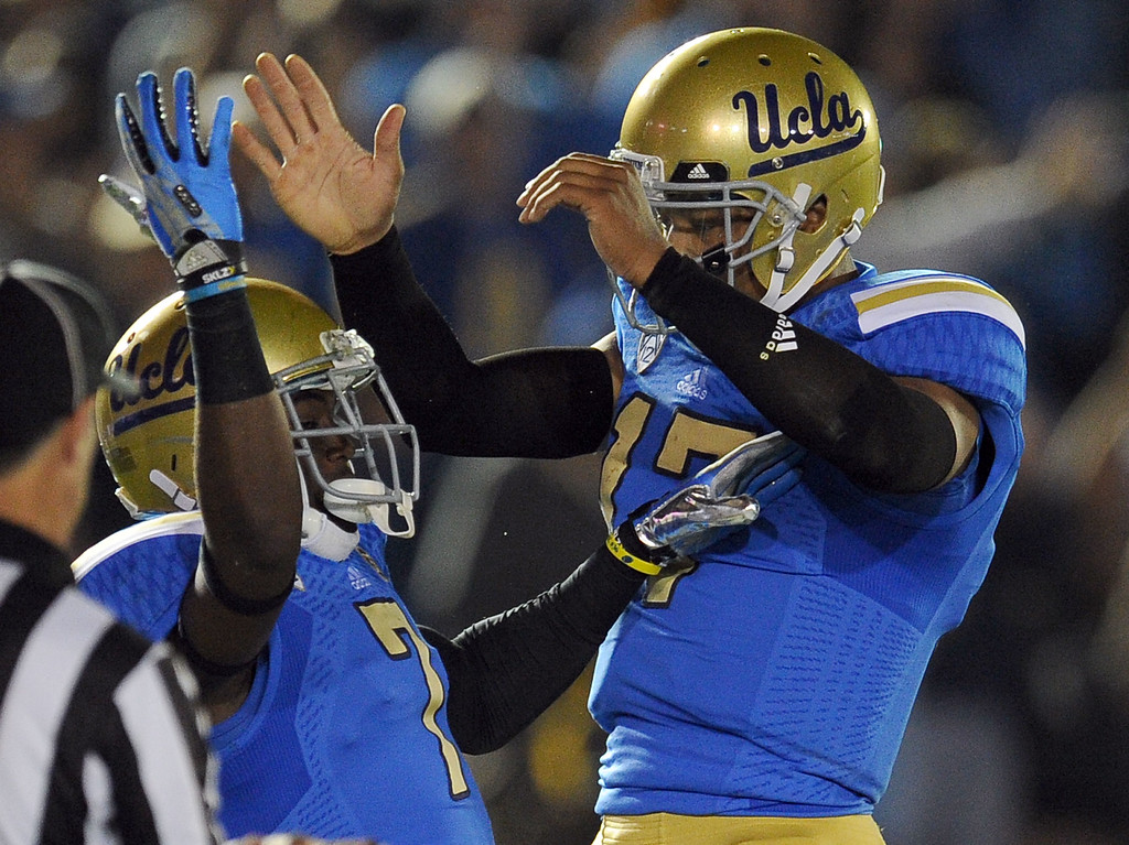 . UCLA wide receiver Devin Fuller (7) celebrates with quarterback Brett Hundley (17) after a touchdown during the first half of their college football game against California in the Rose Bowl in Pasadena, Calif., on Saturday, Oct. 12, 2013.   (Keith Birmingham Pasadena Star-News)
