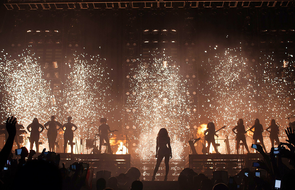 """. Singer Beyonce performs on her \""""Mrs. Carter Show World Tour 2013,\"""" on Saturday, Sept. 28, 2013 at the Coliceo de Puerto Rico in San Juan, Puerto Rico. (Photo by Robin Harper/Invision for Parkwood Entertainment/AP Images)"""