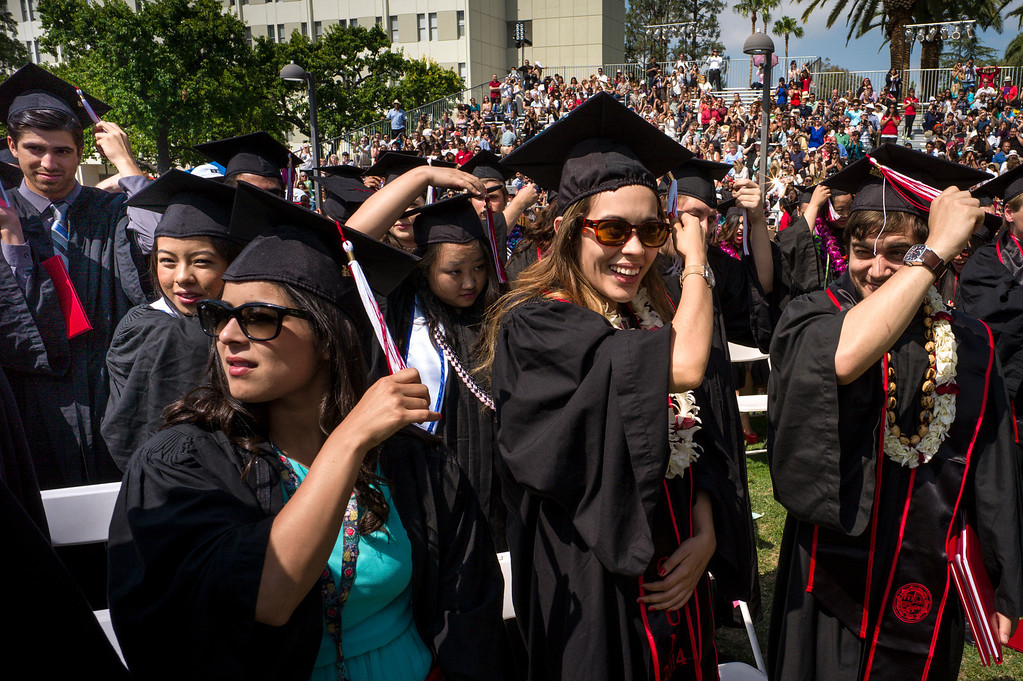 . CSUN grads move their tassels at graduation ceremonies at Cal State Northridge Monday, May 19, 2014.  ( Photo by David Crane/Los Angeles Daily News )
