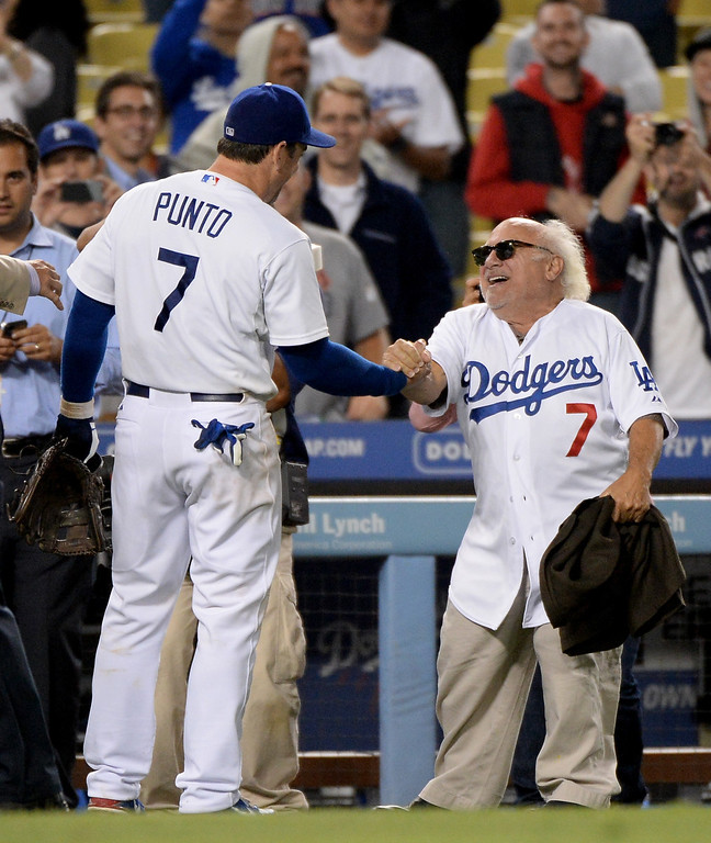 . Actor Danny Devito greets Nick Punto #7 of the Los Angeles Dodgers after a 4-2 win over the New York Mets at Dodger Stadium on August 12, 2013 in Los Angeles, California.  (Photo by Harry How/Getty Images)