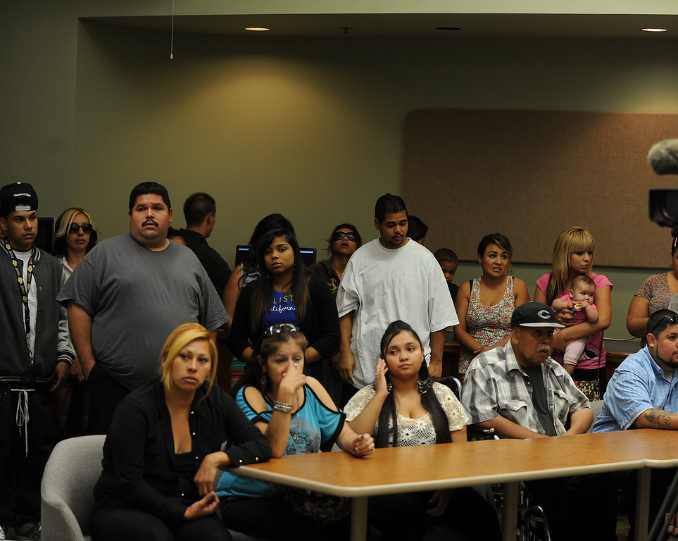 . -Family members attend  a press conference at the San Bernardino County Sheriff\'s Headquarters Thursday August 22, 2013 in San Bernardino for Daniel Olivera 26, of Hesperia who was shot and killed at the AM/PM Arco convenience store on August 11, 2013 in Victorville.LaFonzo Carter/Staff Photograph