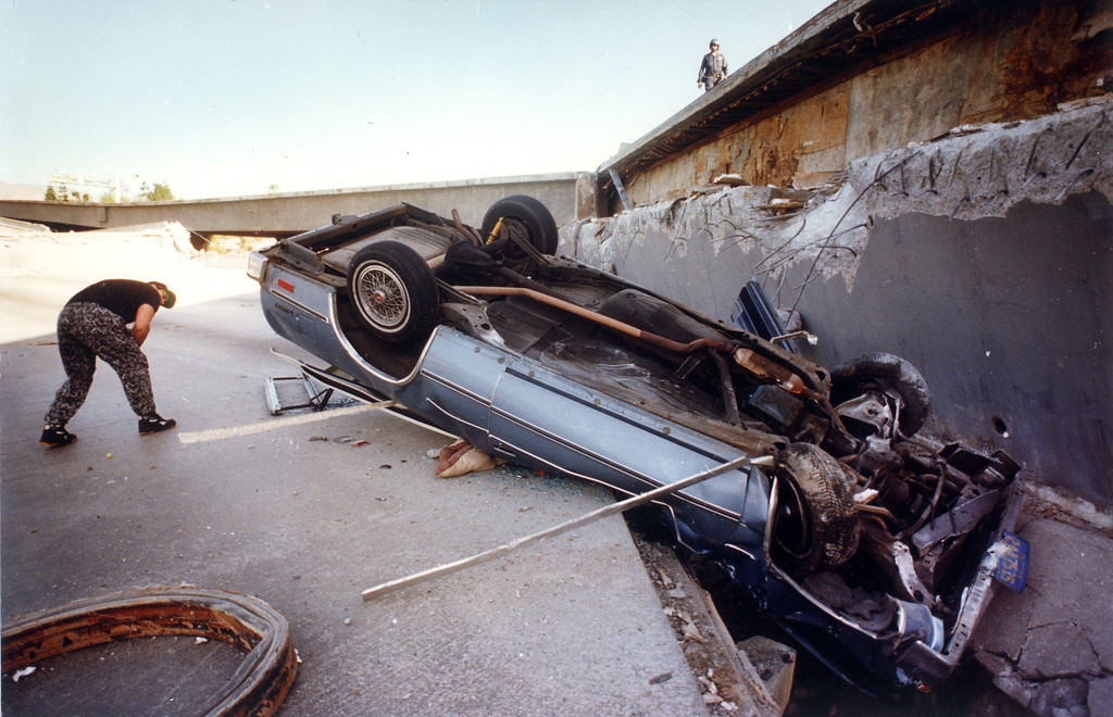 . An auto traveling on the 118 freeway got caught when the freeway collapsed at Gothic Avenue.   Los Angeles Daily News file photo