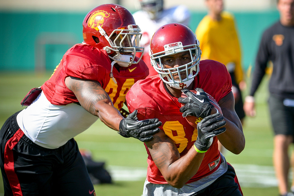 . USC�s Darreus Rogers gets by Jahleel Pinner during spring practice at USC Tuesday, April 15, 2014.  (Photo by David Crane/Los Angeles Daily News.)