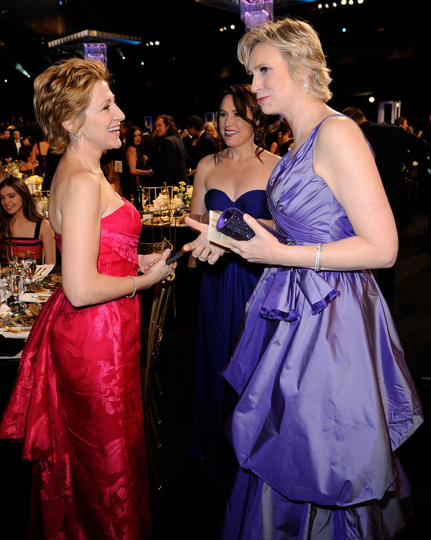 . Edie Falco, left, and Jane Lynch are seen at the 17th Annual Screen Actors Guild Awards on Sunday, Jan. 30, 2011 in Los Angeles. (AP Photo/Mark J. Terrill)