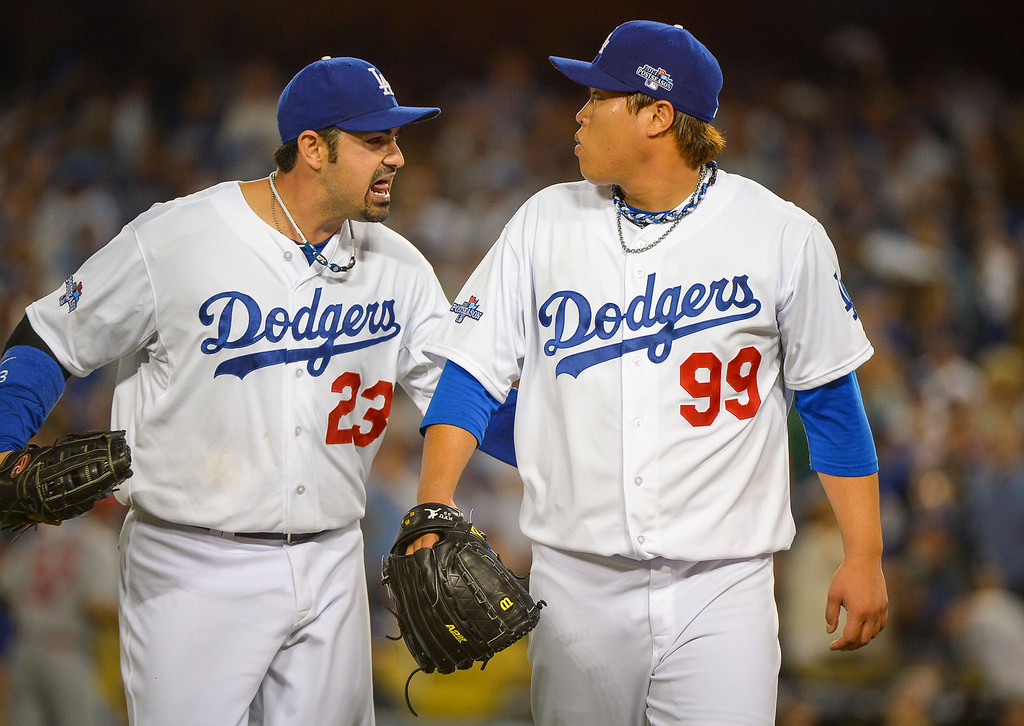 . Dodgers\' Adrian Gonzalez gives some encouragement to Hyun-Jin Ryu  against the Cardinals in NLCS game 3 at Dodger stadium Monday, October 14, 2013 ( Photo by Andy Holzman/Los Angeles Daily News )