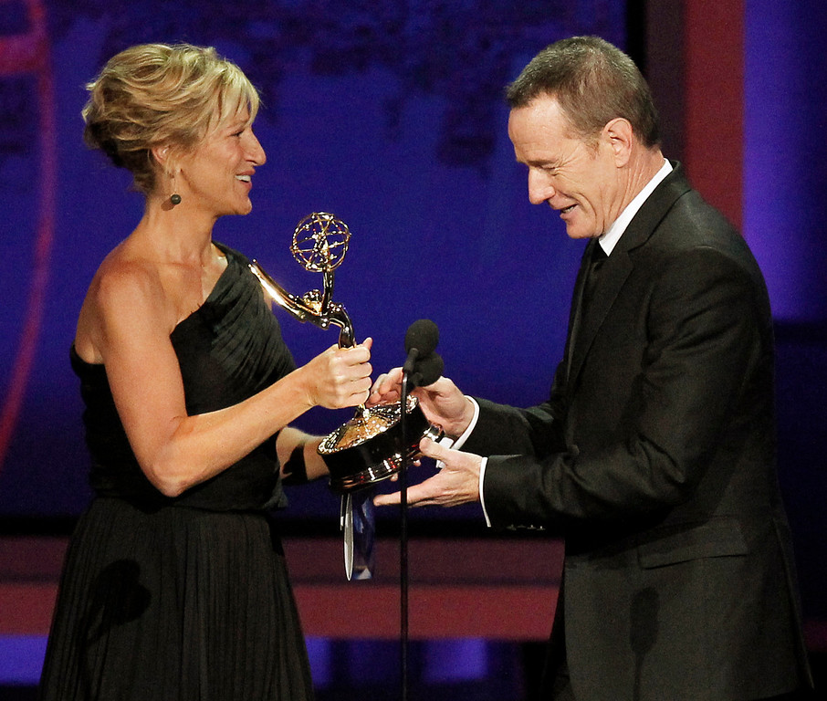 ". Edie Falco presents Bryan Cranston with the award for outstanding lead actor in a drama series for ""Breaking Bad\"" during the 62nd Primetime Emmy Awards Sunday, Aug. 29, 2010, in Los Angeles. (AP Photo/Chris Carlson)"