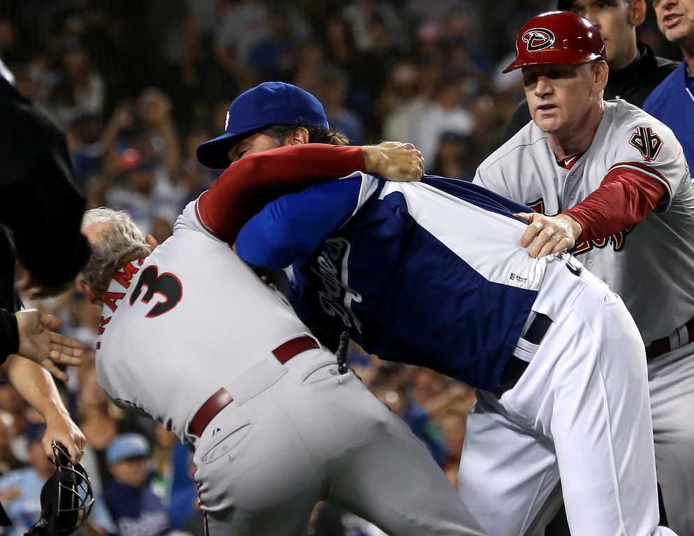 . LOS ANGELES, CA - JUNE 11:  Manager Don Mattingly of the Los Angeles Dodgers pushes down coach Alan Trammell #3 of the Arizona Diamondbacks during as Diamondbacks coach Matt Williams tries to restrain Mattingly a bench clearing brawl in the seventh inning at Dodger Stadium on June 11, 2013 in Los Angeles,  (Photo by Stephen Dunn/Getty Images)