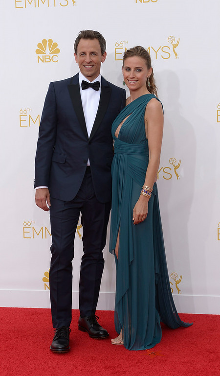. Alexi Ashe (R) and host Seth Meyers on the red carpet at the 66th Primetime Emmy Awards show at the Nokia Theatre in Los Angeles, California on Monday August 25, 2014. (Photo by John McCoy / Los Angeles Daily News)