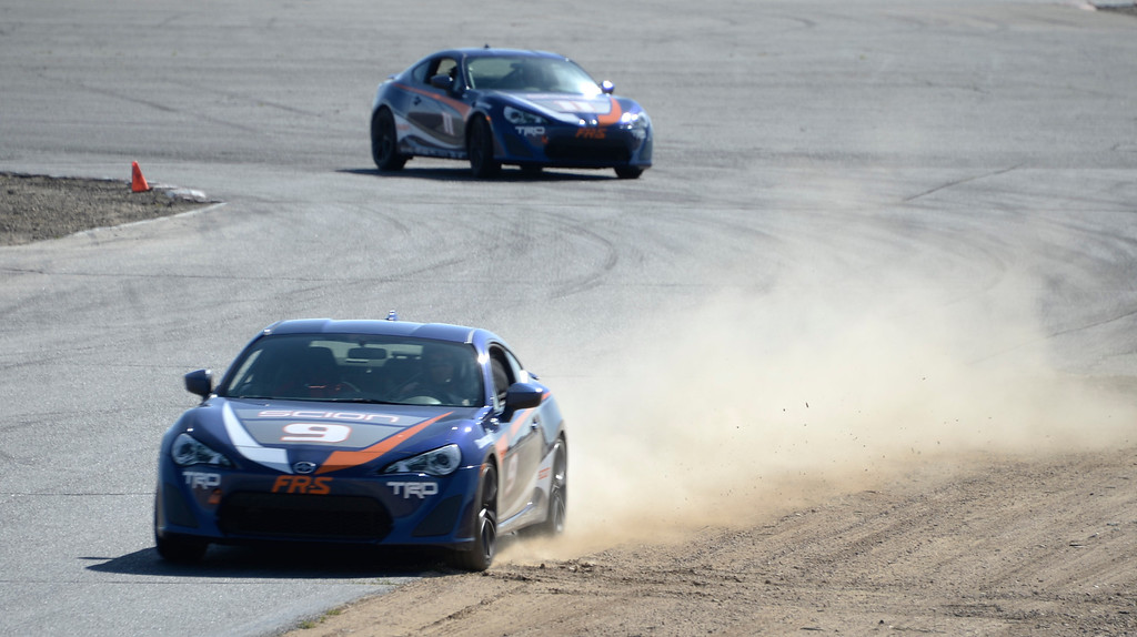 . March 15,2014. Rosamond CA. Academy award winner actor Adrien Brody kicks up some dust on a turn, as celebrities in the Long Beach Grand Prix practice racing with instructors in Toyota race cars at the Willow Springs International Raceway. photo  by Gene Blevins/LA DailyNews