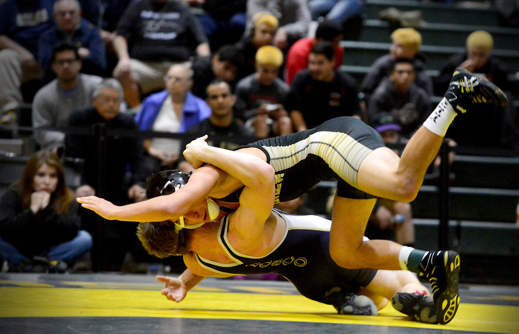 . Northview\'s Ricky Padilla defeats St. John Bosco\'s Matthew Williams during the semifinals of the CIF-SS Division 2 wrestling finals at South Hills High School in West Covina Saturday night, February 8, 2014. Northview claimed championship after defeating Servite 42-30. (Photo by Sarah Reingewirtz/Pasadena Star-News)