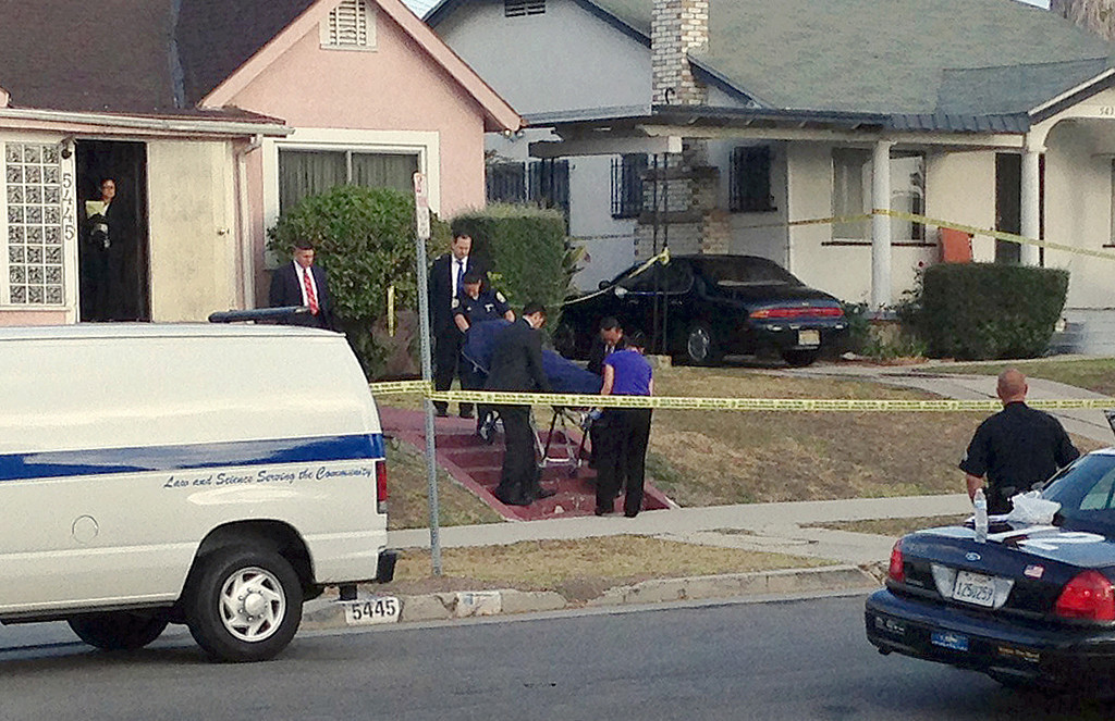 ". Los Angeles County coroner\'s officials remove the body of April Jace, the wife of actor Michael Jace, from the couple\'s home in the Hyde Park area of Los Angeles Tuesday morning, May 20, 2014. Michael Jace, who played a police officer on the hit TV show ""The Shield,\"" was arrested Tuesday on suspicion of shooting his wife to death, authorities said. (AP Photo/Dwight Flowers)"