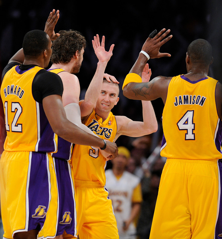 . Lakers#5 Steve Blake is congratulated on his 3 pointer late in the 4th quater that put the Lakers ahead. The Lakers defeated the Houston Rockets in overtime 99-95 in the final home game of the year at Staples Center in Los Angeles, CA 4/17/2013 (John McCoy/Los Angeles Daily News)