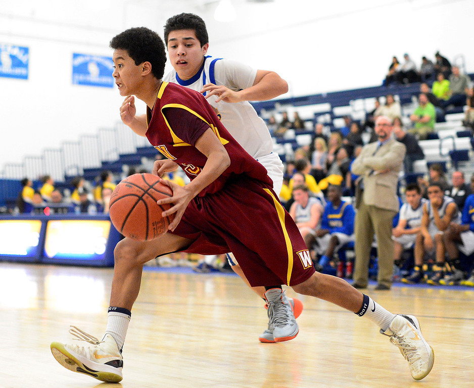 . Wilson\'s Kyle Price (3) heads for a pass as Wilson defeats San Dimas 45-43 Friday night, January 10, 2014 at San Dimas High School.  (Photo by Sarah Reingewirtz/Pasadena Star-News)