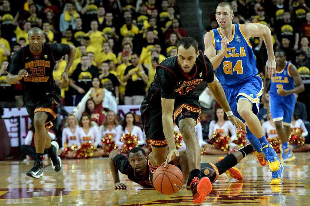 . Southern California\'s Julian Jacobs (12) recovers a loose ball ahead of UCLA\'s Travis Wear (24) in the second half of a PAC-12 NCAA basketball game at Galen Center in Los Angeles, Calif., on Saturday, Feb. 8, 2014. UCLA won 83-73. (Keith Birmingham Pasadena Star-News)