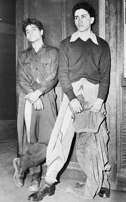 """. Noe Vasquez, left, 18, and Joe Vasquez, 18, unrelated to Noe, reported to Los Angeles, Calif., police they were seized by sailors who tore peg-topped trousers, although one youths wore overalls over them, June 12, 1943.  Police said the sailors may have been passing through the city since the area where the attack allegedly occurred was an \""""out of bounds area for the Navy.\"""" (AP Photo)"""