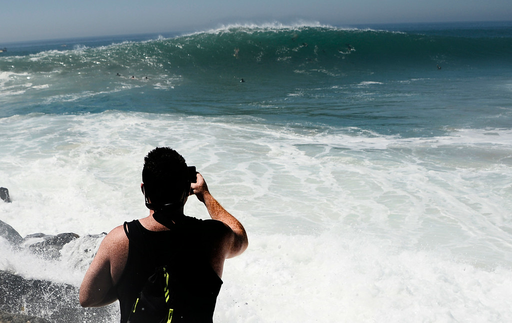 . Aug 27,2014, Newport Beach CA. Thousands of beach goers came out to see the surfers go head on a second day with 20-25 foot waves at the Wedge Wednesday morning. The big surf affect is from hurricane Marie down south and is last a few days with big surf hitting the south facing beaches. Photo by Gene Blevins/LA Daily News