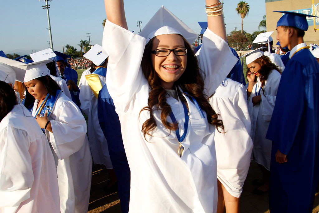 . Jubilant graduate Dasia Vasquez, during the El Monte High School Class of 2014 Commencement Ceremony, at El Monte High School\'s Football Stadium in El Monte, CA., Wednesday, June 11, 2014.  (Photo by James Carbone for the San Gabriel Valley Tribune)