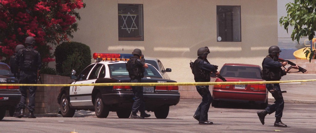 . Los Angeles Police Officers lead search for suspects after Buford O. Furrow, Jr. walked into the lobby of the North Valley Jewish Community Center in Granada Hills and opened fire with a semiautomatic weapon. Los Angeles Daily News file photo.