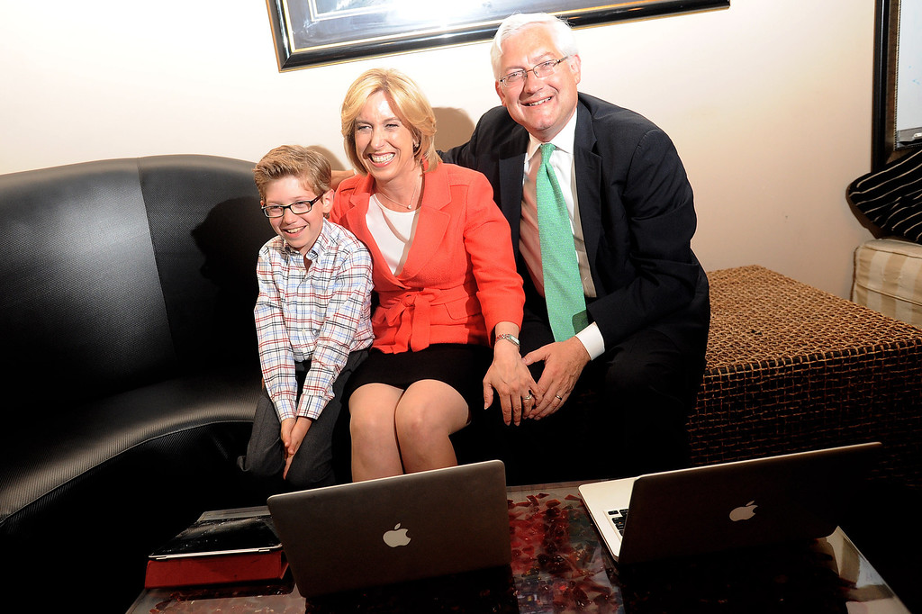 . Mayoral candidate Wendy Greuel watches election results with husband Dean Schramm and son Thomas during her election night party at the Exchange in Los Angeles, CA May 21, 2013.(Andy Holzman/Staff Photographer)