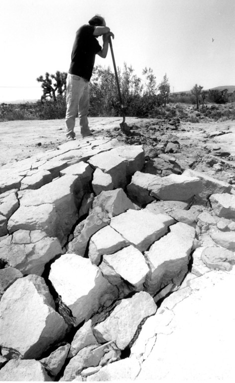 . June 28, 1992: Mike Leonard of Flamingo, CA, takes a breather from shoveling soil on a road to fill cracks that appeared during Sunday\'s quakes.  Daily News file photo