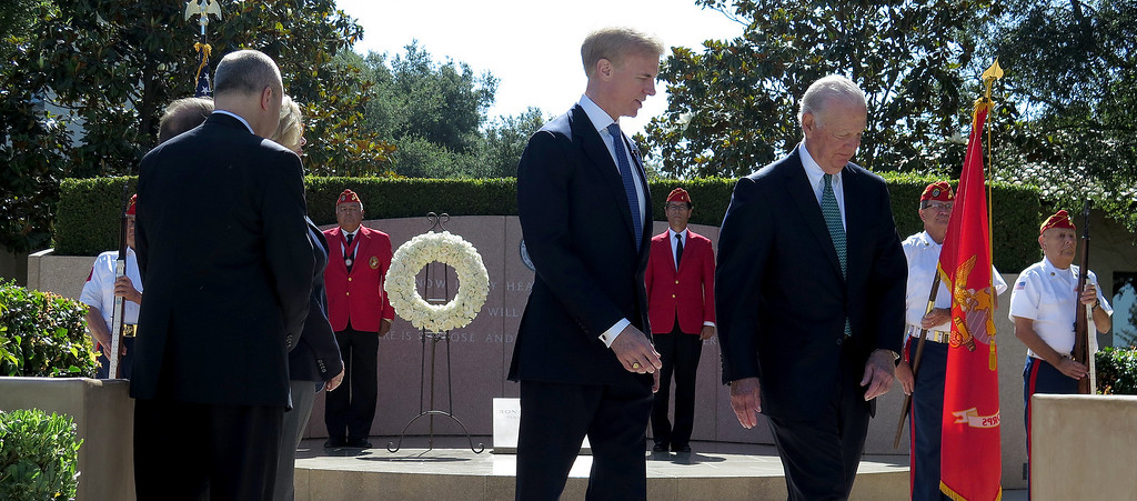 . On June 5, 2014, the Ronald Reagan Presidential Foundation commemorated anniversaries with a special program at his Presidential Library that focused on his legacy and impact on the country after so many years since leaving office.  Wreath Laying Ceremony at President Reagan�s Gravesite included Secretary James Baker, at right, and Reagan Foundation Board Chairman Frederick J. Ryan, Jr., center, with the assistance of the Marine Corps League President Ronald Reagan Detachment. (Photo by Dean Musgrove/Los Angeles Daily News)