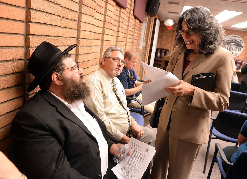 . Hillel Schrier (left), a Rialto middle school teacher, and Russel Silva (center), a Rialto resident, both listen to Rabbi Suzanne Singer (right), from the Temple Beth El in Riverside following the public comment portion of a special emergency of the Rialto Unified School District board  Wednesday May 7, 2014 to address the critical thinking assignment given to middle school students on whether the Holocaust occurred or was merely a political scheme created to influence public emotion and gain. (Will Lester/Inland Valley Daily Bulletin)