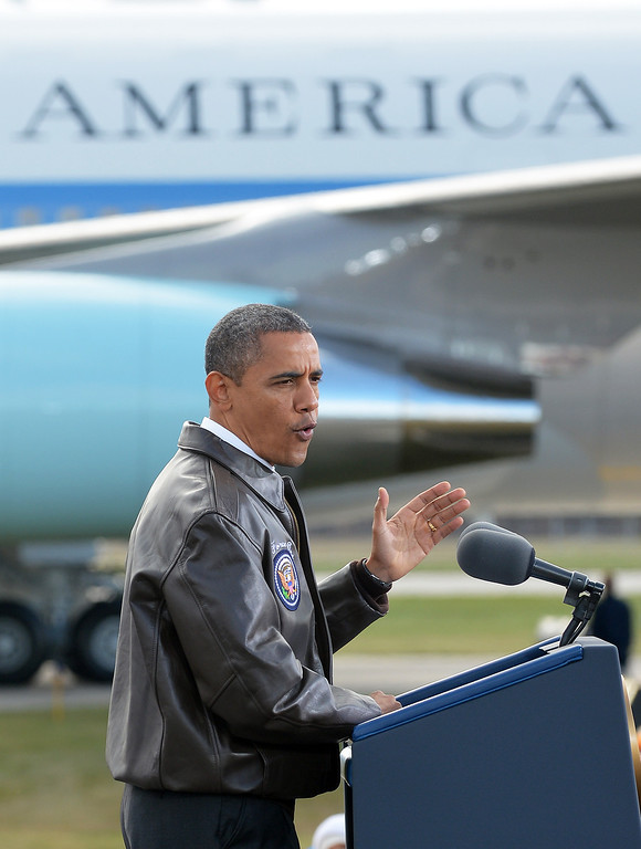 . US President Barack Obama speaks during a campaign rally on a tarmac of Austin Straubel International Airport in Green Bay, Wisconsin, on November 1, 2012.        (JEWEL SAMAD/AFP/Getty Images)
