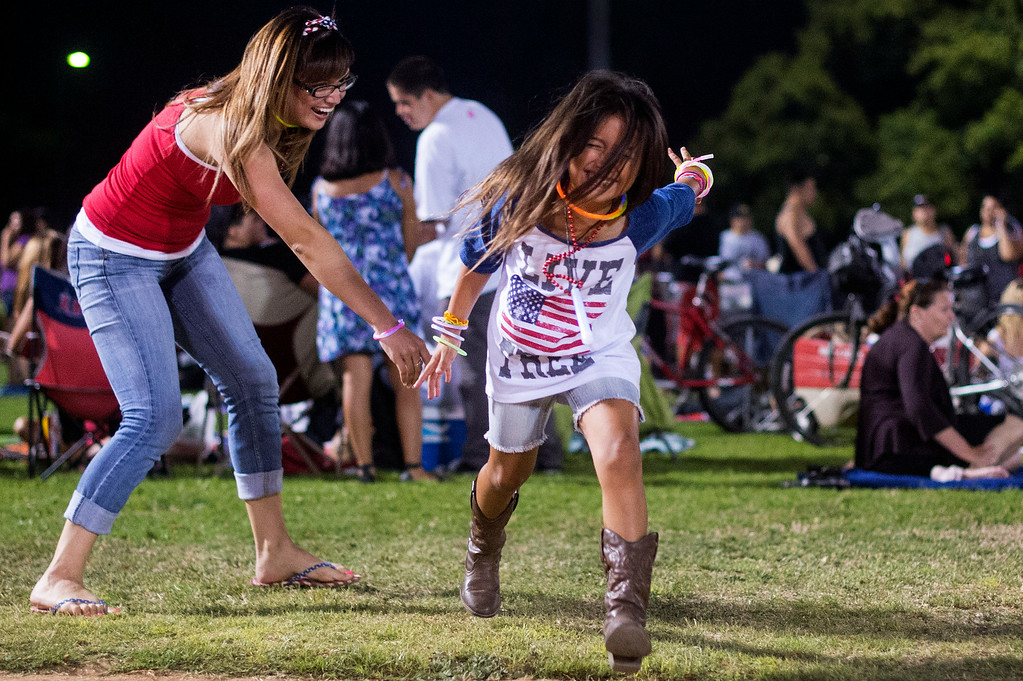 ". ""It\'s tradition to see the fireworks on the 3rd of July. My parents too me now I take her,\"" says Jennifer Duran who plays tag with her 6-year-old daughter Ryan Holmen before La Mirada\'s annual fireworks show Thursday night, July 3, 2014 at La Mirada Regional Park. (Photo by Sarah Reingewirtz/Pasadena Star-News)"