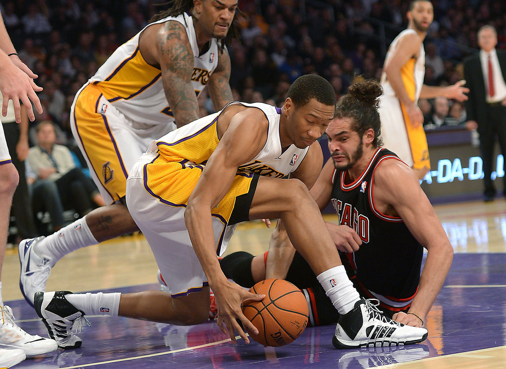 . The Los Angeles Lakers\' Wesley Johnson grabs a loose ball over Chicago Bulls\' Joakim Noah in a NBA basketball game at Staples Center in Los Angeles, CA. on Sunday, February 9, 2014. (Photo by Sean Hiller/ Daily Breeze).
