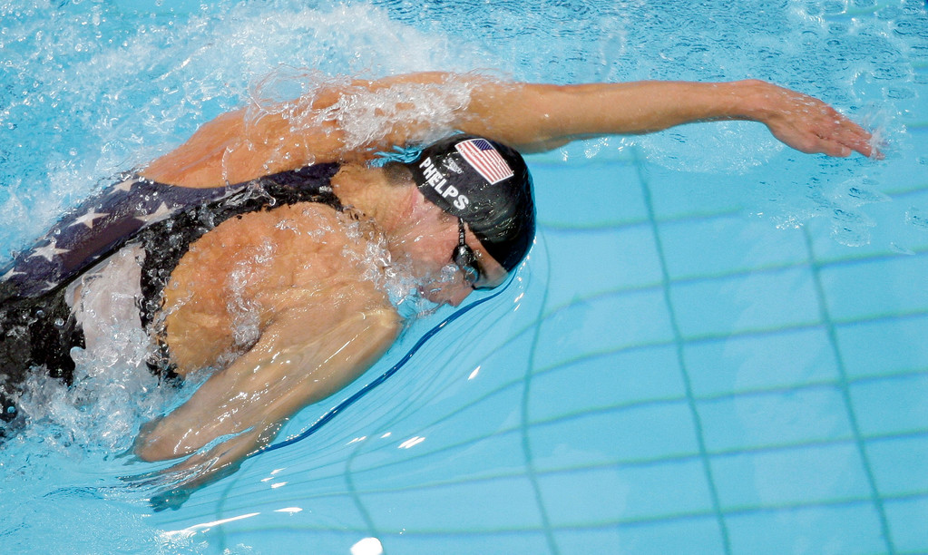 . Michael Phelps of the United States swims on his way to winning the gold medal in the men\'s 200-meter freestyle with a world record during the swimming competitions in the National Aquatics Center at the Beijing 2008 Olympics in Beijing, Tuesday, Aug. 12, 2008. (AP Photo/Greg Baker)
