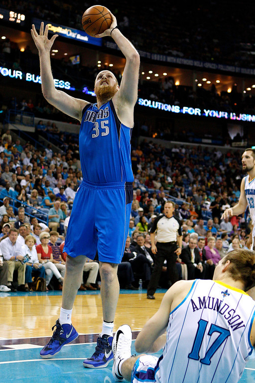 . Dallas Mavericks center Chris Kaman (35) goes to the basket over New Orleans Hornets power forward Lou Amundson (17) during the first half of an NBA basketball game in New Orleans, Sunday, April 14, 2013. The Mavericks won 107-89. (AP Photo/Jonathan Bachman)