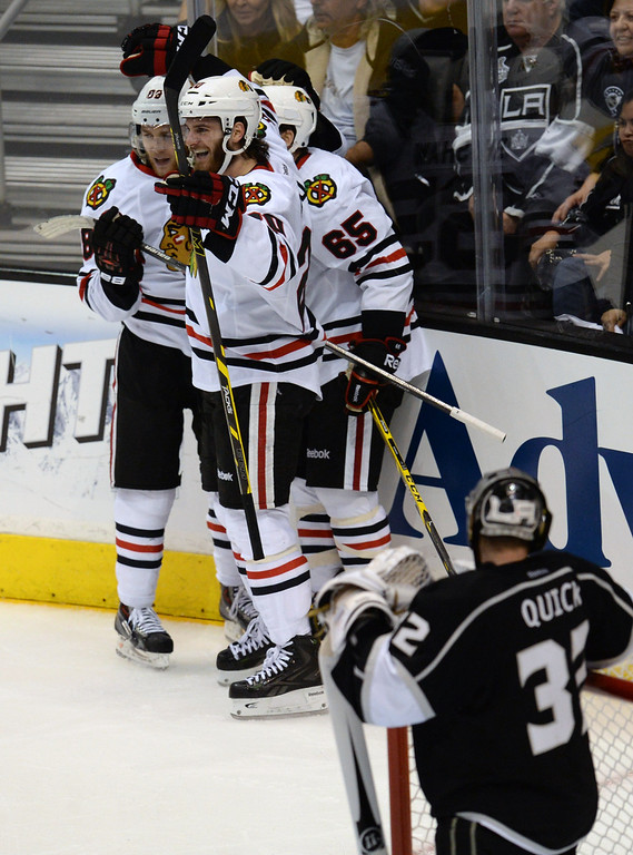 . Blackhawks� Patrick Kane #88 celebrates  with teammates after his game winning goal in the third period during Game 6 of the Western Conference finals against the Kings at the Staples Center on Friday, May 30, 2014. The Blackhawks beat the Kings 4-3. (Photo by Hans Gutknecht/Los Angeles Daily News)