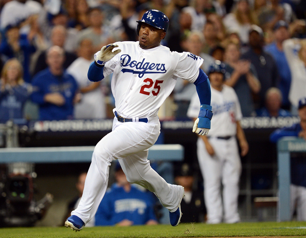 . The Dodgers\'  Carl Crawford  slides in to home to score in the 8th during game 3 of the NLCS against the Cardinals at Dodger Stadium Monday, October 14, 2013. (Photo by Hans Gutknecht/Los Angeles Daily News)