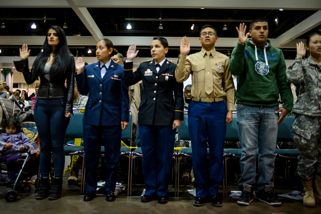 . US Citizen candidates are sworn in as US citizens at the Los Angeles Convention Center Tuesday, December 17, 2013.  3,793 immigrants were sworn in as New US citizens at the ceremony.  ( Photo by David Crane/Los Angeles Daily News )