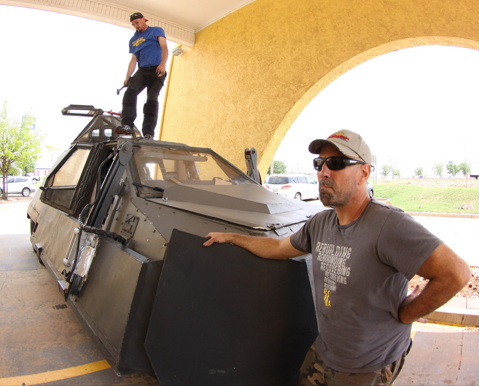 . Sean Casey(R) IMAX film-maker/Storm Chaser with TIV-2 (Tornado Intercept Vehicle) and driver Jonathon Morrison as they gets ready to start on another tornado IMAX film with the National Geographic in El Reno, Oklahoma Friday April 25,2014.April  26,2014. Photo by Gene Blevins/LA Daily News