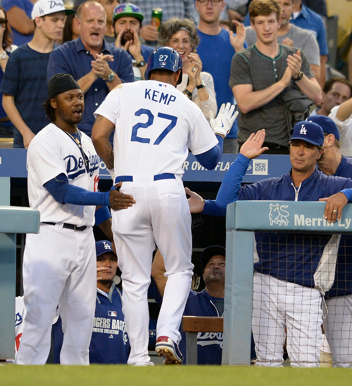 . Matt Kemp is congratulated on his 2nd inning homer. The Dodgers played host to the Atlanta Braves in a game played at Dodger Stadium in Los Angeles, CA. 7/30/2014(Photo by John McCoy Daily News)