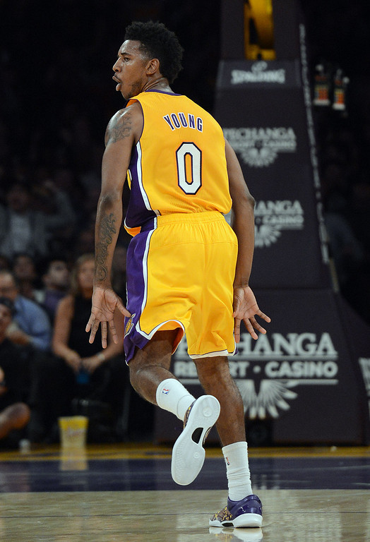 . The Lakers� Nick Young #0 reacts after hitting a basket late in the first half during their game against the Grizzlies at the Staples Center in Los Angeles Friday, November 15, 2013. (Photo by Hans Gutknecht/Los Angeles Daily News)