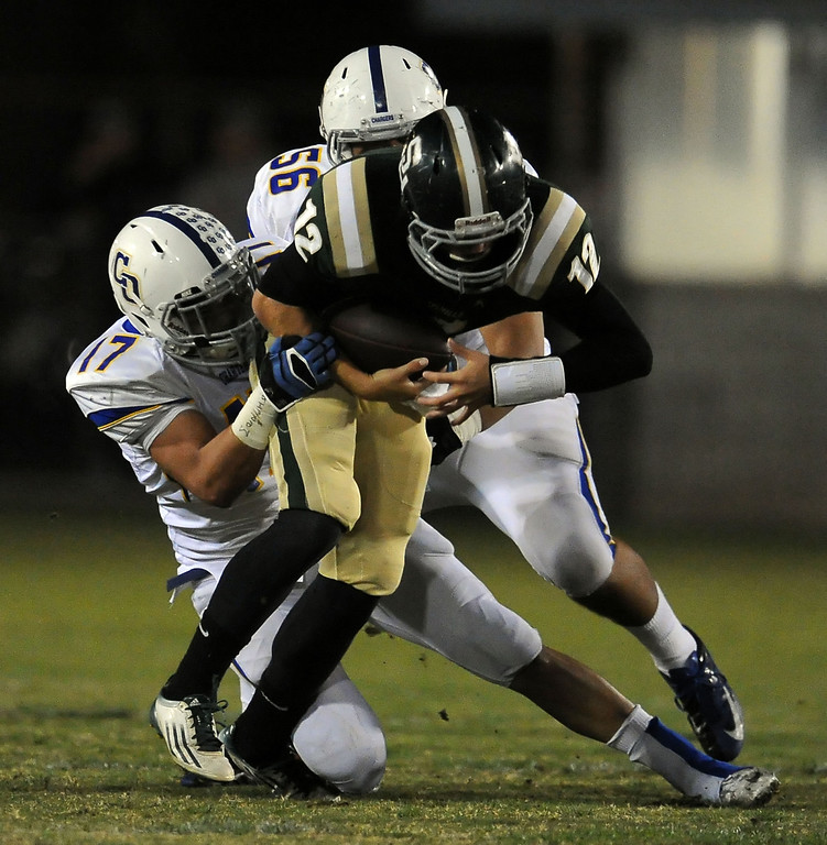 . Charter Oak\'s Jason Ortiz (17) sacks South Hills quarterback Adam Goss (12) along with David Apodaca (56) in the first half of a prep football game at Covina DIstrict Field in Covina, Calif., on Thursday, Oct. 24, 2013. 