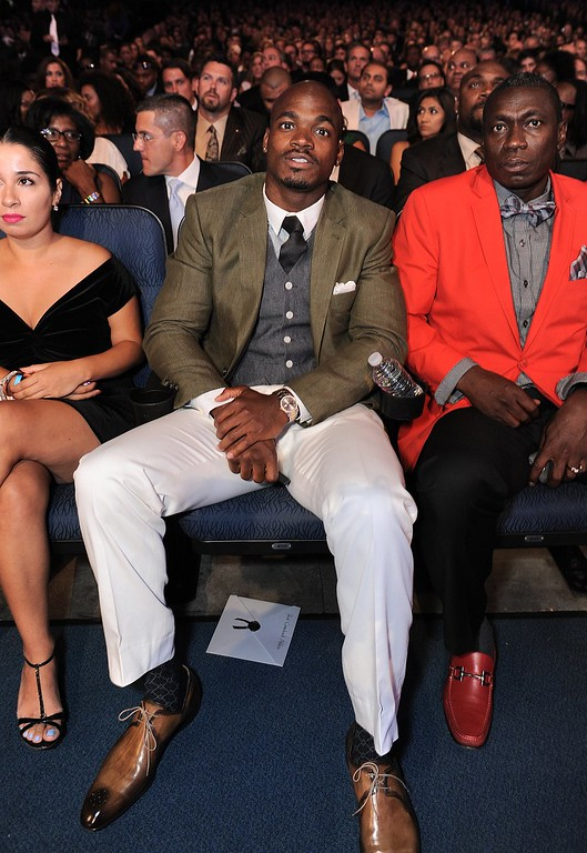 . Adrian Peterson is seen in the audience at the ESPY Awards on Wednesday, July 17, 2013, at the Nokia Theater in Los Angeles. (Photo by Jordan Strauss/Invision/AP)